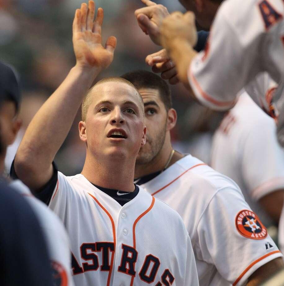 Astros third baseman Matt Dominguez (30) celebrates his run after a RBI double by Marwin Gonzalez (9). Photo: Karen Warren, Houston Chronicle