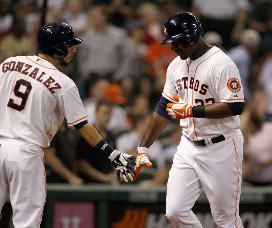 Astros left fielder Chris Carter (23) celebrates his home run with shortstop Marwin Gonzalez (9). Photo: Karen Warren, Houston Chronicle
