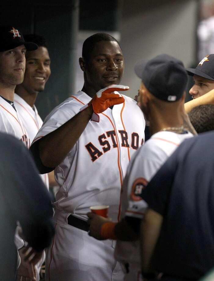 Astros left fielder Chris Carter (23) celebrates his home run with teammates.