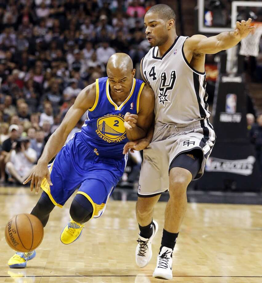 Golden State Warriors' Jarrett Jack drives around San Antonio Spurs' Gary Neal during first half action of Game 2 in the NBA Western Conference semifinals Wednesday May 8, 2013 at the AT&T Center.