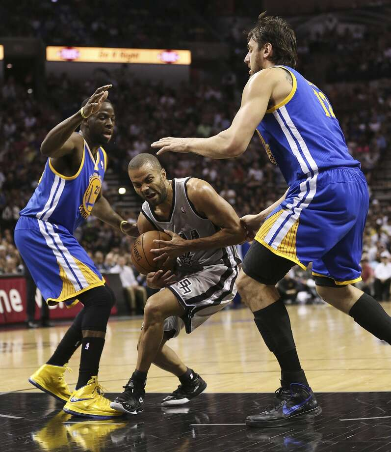 San Antonio Spurs' Tony Parker gets through Golden State Warriors' Draymond Green, left, and Andrew Bogut during the first half of Game 2 in the NBA Western Conference semifinals at the AT&T Center, Wednesday, May 8, 2013.
