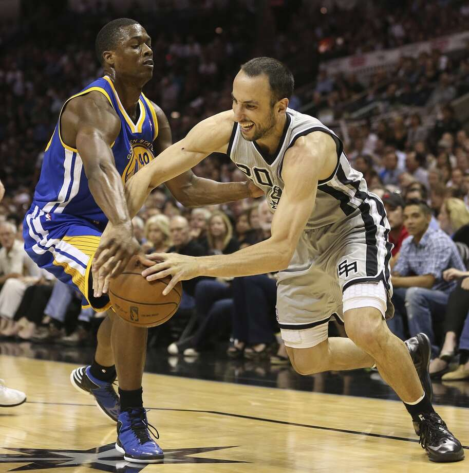San Antonio Spurs' Manu Ginobili gets pressure from Golden State Warriors' Harrison Barnes during the first half of Game 2 in the NBA Western Conference semifinals at the AT&T Center, Wednesday, May 8, 2013.