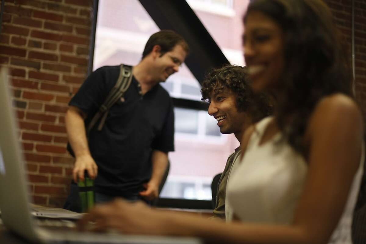 Parag Chordia (center), Smule chief scientist, shares a laugh with Randal Leistikow (left), Smule software engineer and Prerna Gupta (right), Smule chief product officer while working at Smule's offices on Wednesday, May 8, 2013 in San Francisco, Calif.