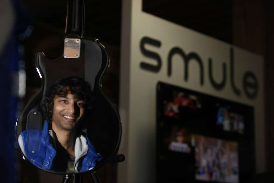 Smule chief scientist, Parag Chordia, is seen reflected in the back of a guitar at Smule's offices in San Francisco. Photo: Lea Suzuki, The Chronicle