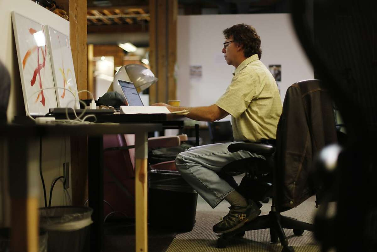 Jeff Smith, Smule CEO, works on a laptop at Smule's offices on Wednesday, May 8, 2013 in San Francisco, Calif.