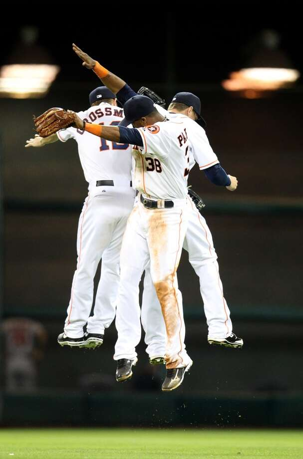 May 8: Astros 3, Angels 1 Astros center fielder Robbie Grossman (19), Jimmy Paredes (38), and Brandon Barnes (2) celebrate in the outfield after their win over the Angels.
