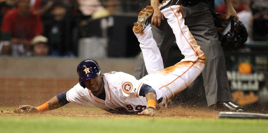 Astros shortstop Jimmy Paredes (38) is called out at the plate after a bunt by Jose Altuve (27). Photo: Karen Warren, Houston Chronicle
