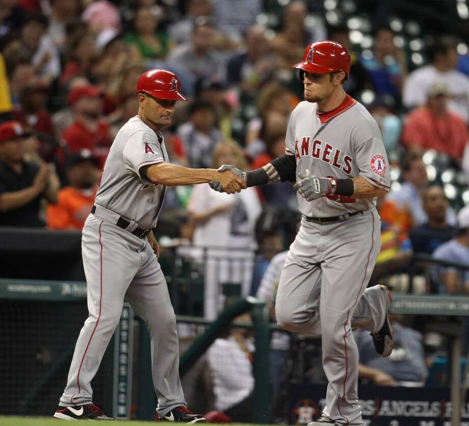 Angels right fielder Josh Hamilton (32) rounds the bases after his home run.