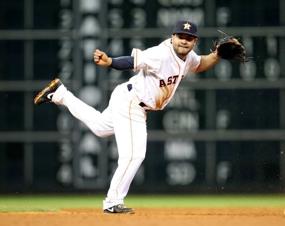 Astros second baseman Jose Altuve (27) finishes the double play throw to first to end the game.