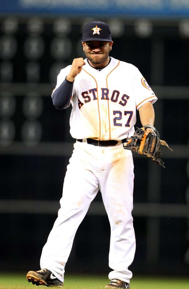 Astros second baseman Jose Altuve (27) reacts after his double play throw to first that ended the game.