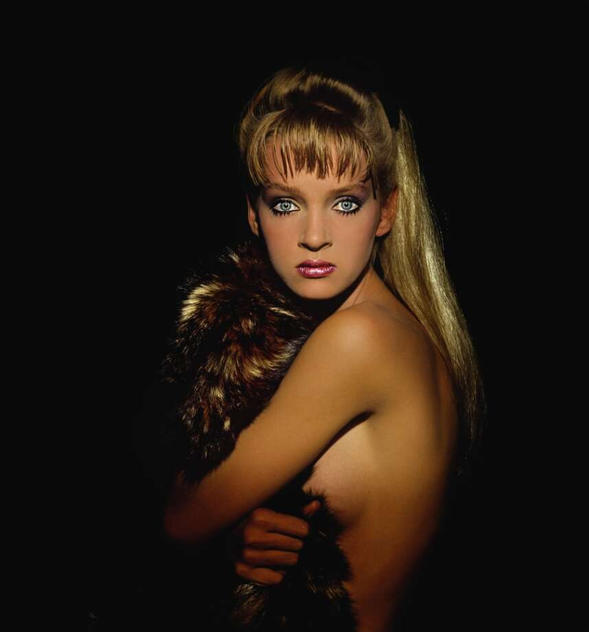 Uma Thurman, clutching something furry ... and alive? Mid-'80s.
