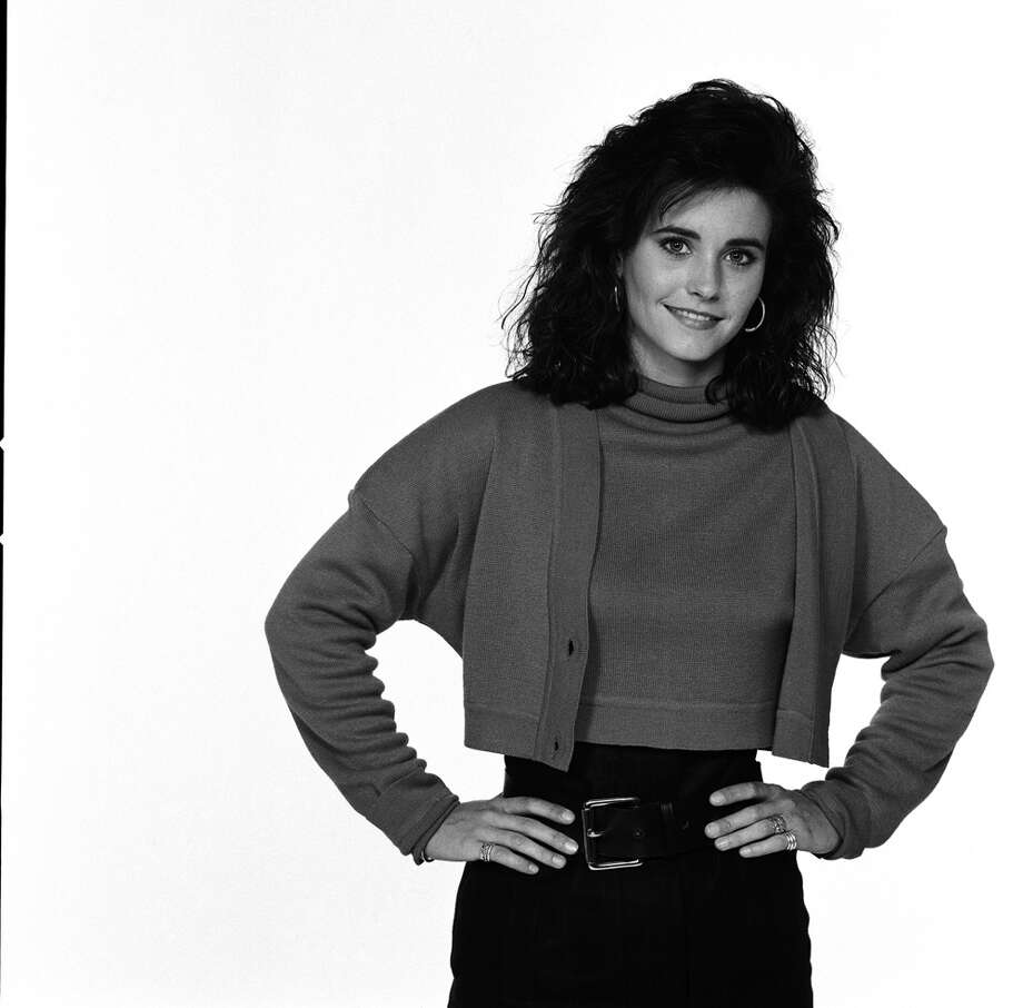 "Courteney Cox wears the frumpiest sweater set imaginable in this portrait for ""Family Ties,"" in which she played Lauren Miller in the '80s. Photo: NBC, NBC Via Getty Images / © NBC Universal, Inc."