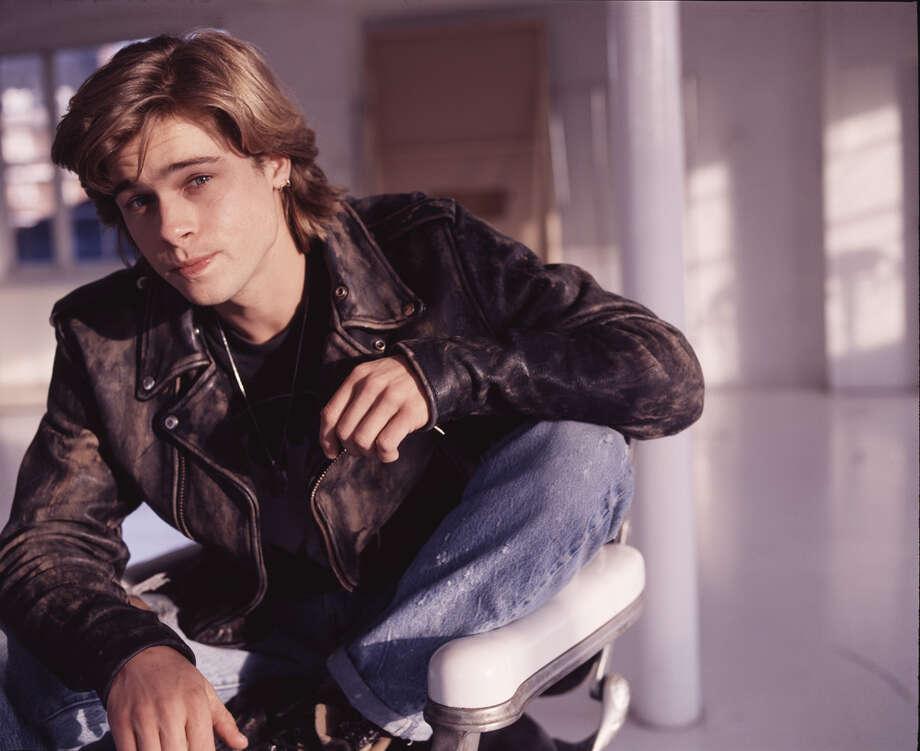Brad Pitt, 1988, squinting in London. Photo: Michael Putland