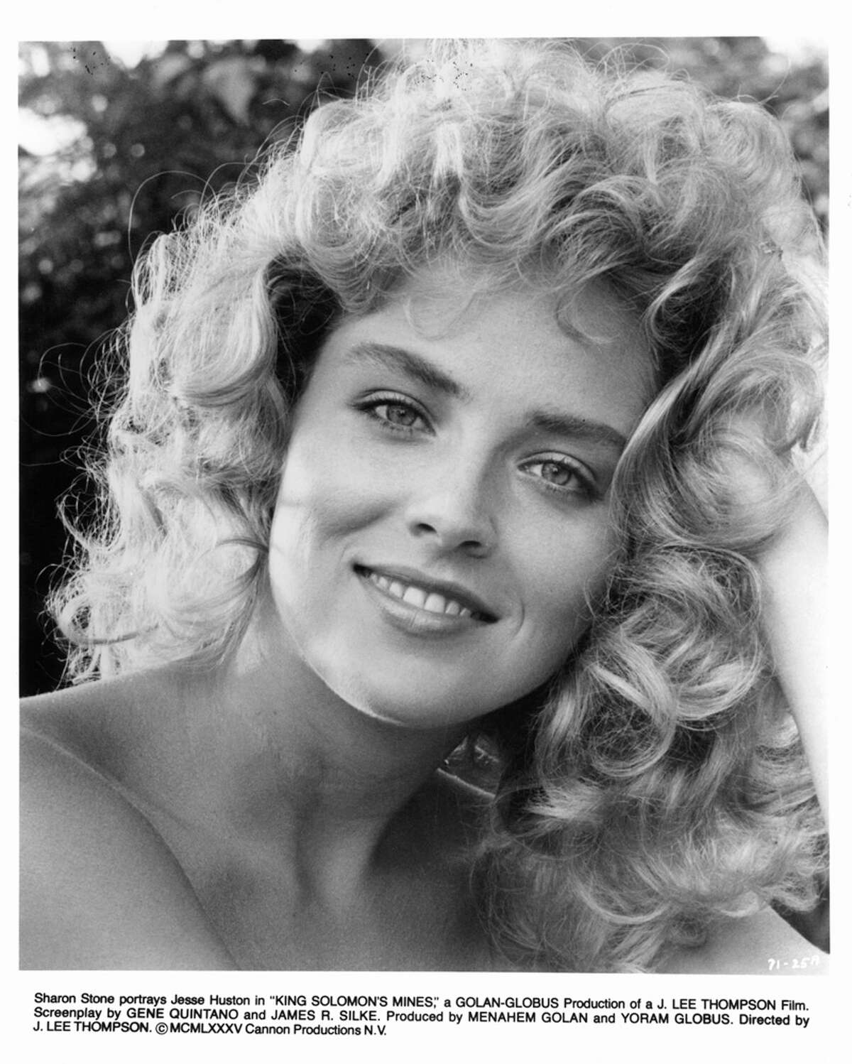 No. 3. She has an IQ of 154, according to The Times. (Above: with curls in 1985.)