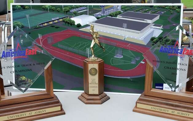 Trophies and a rendering of the new track are displayed at a groundbreaking ceremony for the new track and field facility at UAlbany on Wednesday, May 8, 2013 in Albany, N.Y. (Lori Van Buren / Times Union) Photo: Lori Van Buren / 00022312A