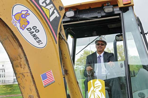 UAlbany head coach Roberto Vives sits in the seat of a backhoe during a groundbreaking ceremony for the new track and field facility on Wednesday, May 8, 2013 in Albany, N.Y. (Lori Van Buren / Times Union) Photo: Lori Van Buren / 00022312A