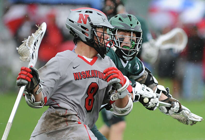 Niskayuna's Aidan O'Brien, left, is defended by Shenendehowa's Peter Sacks during a lacrosse game on
