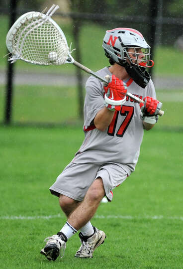 Niskayuna goalie Evan Quinn gets ready to throw the ball up field during a lacrosse game against She