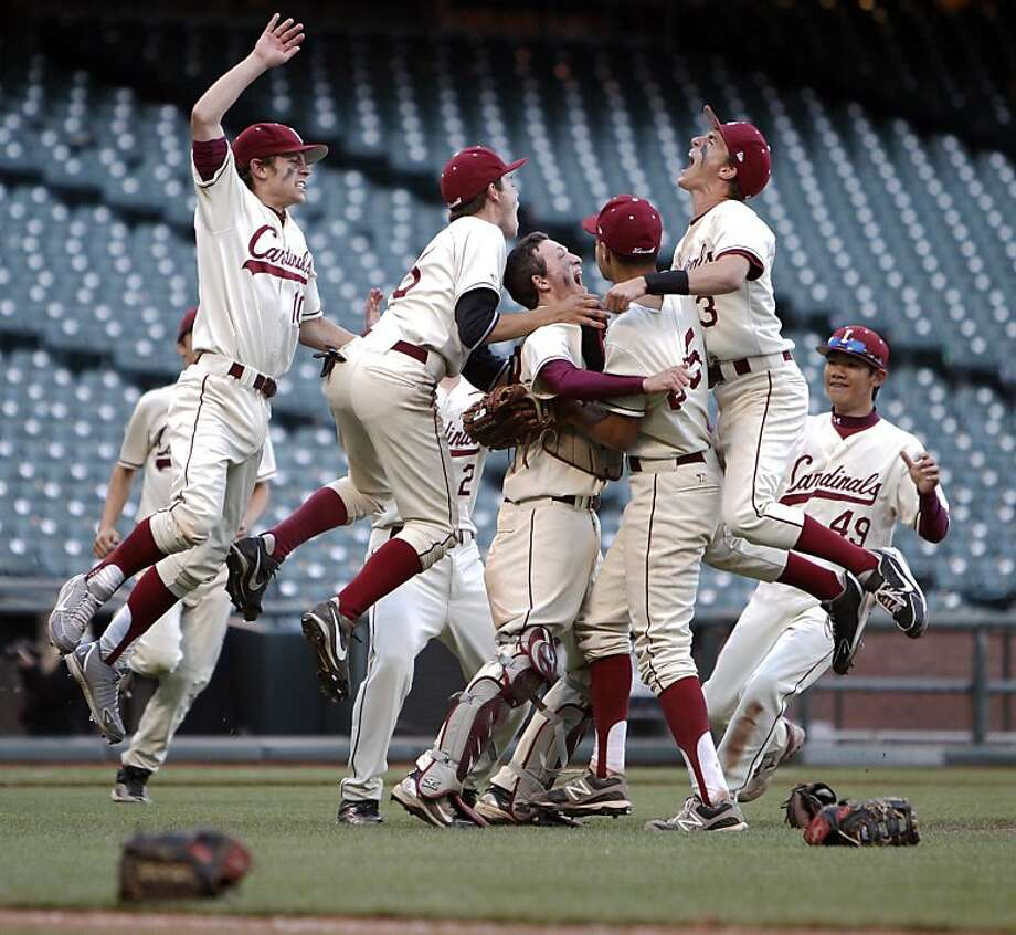 The Lowell Cardinals rush the field after they defeated the Washington Eagles on Wednesday. The Lowell High School Cardinals played the Washington High School Eagles in the San Francisco CIF Spring Championships at AT&T Park in San Francisco, Calif,. on Wednesday, May 8, 2013. Photo: Carlos Avila Gonzalez, The Chronicle