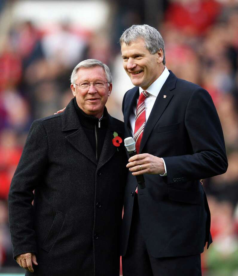 (FILE PHOTO) Manchester United manager Sir Alex Ferguson has announced that he will retire at the end of the season after 26 years in charge. MANCHESTER, ENGLAND - NOVEMBER 05:  Chief Executive David Gill (r) announces the name changing of the North Stand to the 'Sir Alex Ferguson Stand' to commemerate Sir Alex's 25th year as Manager during the Barclays Premier League match between Manchester United and Sunderland at Old Trafford on November 5, 2011 in Manchester, England.  (Photo by Richard Heathcote/Getty Images) Photo: Richard Heathcote, Staff / 2011 Getty Images