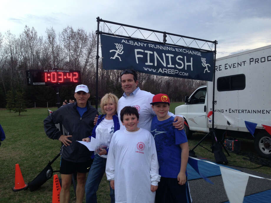 The Albany County Bar Association's annual Law Day Run Against Domestic Violence was conducted on April 24. Among those participating were, from left, Daniel Coffey, Bowitch & Coffey; Barbara Davis, executive director of the bar association and attorney J. Mitchell Tacy, Connor Tacy and James Tacy (Dorian Ryan)