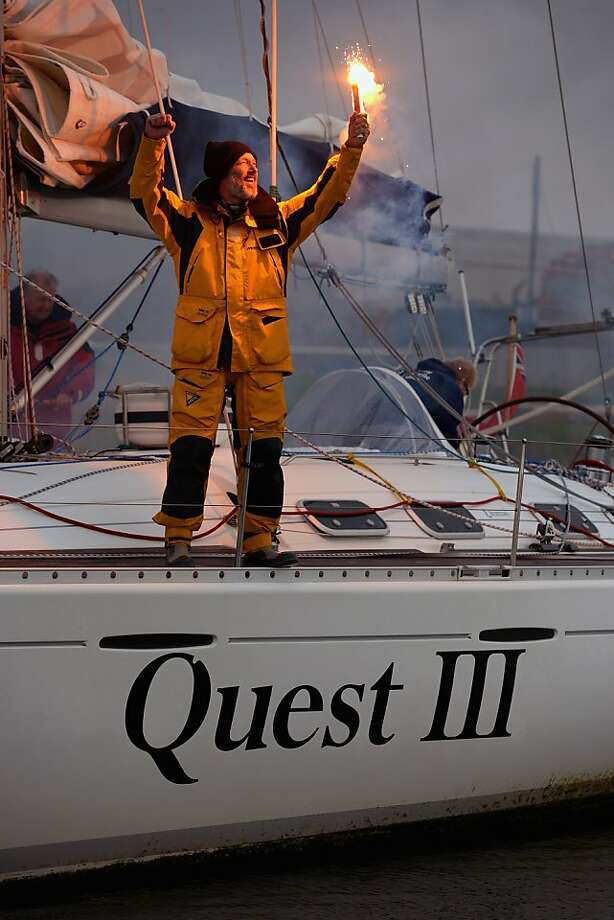 Deaf circumnavigator:Gerry Hughes lights a flare on his yacht Quest III in Troon, Scotland, after sailing solo 