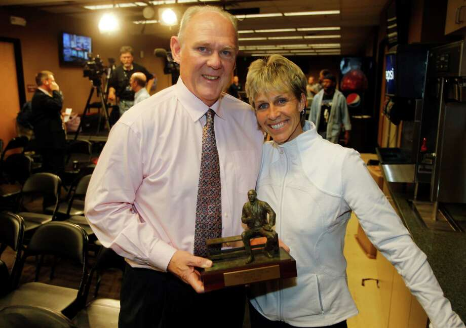 Denver Nuggets head coach George Karl, left, holds the Red Auerbach trophy along with his partner, Kim Van Deraa, after a news conference at which Karl was named the NBA Coach of the Year Wednesday, May 8, 2013, in Denver. (AP Photo/David Zalubowski) Photo: David Zalubowski, STF / AP
