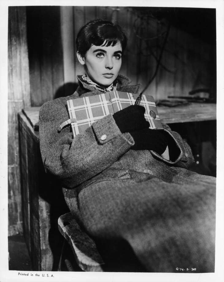 Millie Perkins holding diary in a scene from the film 'The Diary Of Anne Frank', 1959. (Photo by 20th Century-Fox/Getty Images)