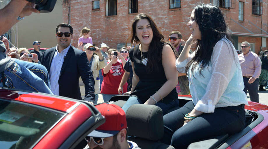 AMERICAN IDOL:  Kree Harrison (L) and sister Laci (R) riding in Kree's hometown parade in Woodville, TX. CR: Michaek Becker / FOX. Photo: Michael Becker