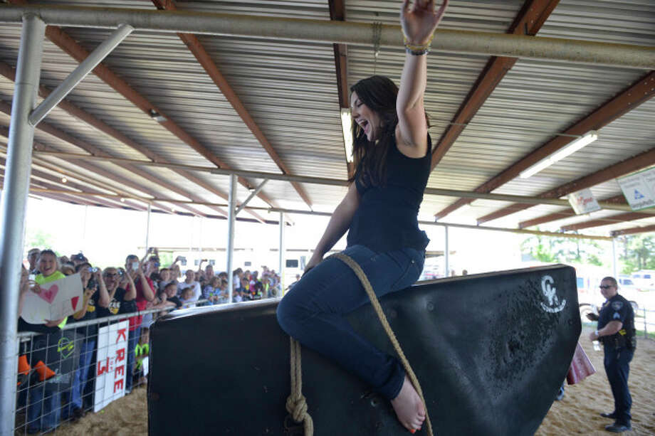 AMERICAN IDOL:  Kree Harrison rides the mechanocal bull at the rodeo near Woodville, TX. CR: Michaek Becker / FOX. Photo: Michael Becker