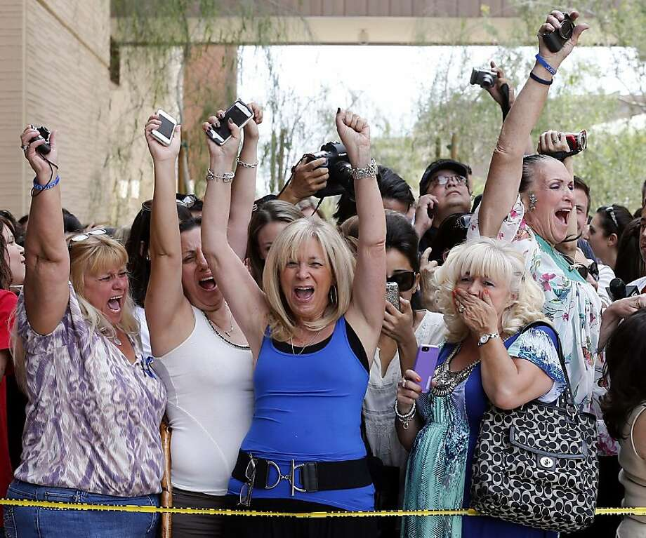Spectators react to a guilty verdict in the murder trial of Jodi Arias, Wednesday, May 8, 2013 in Phoenix. Arias was convicted of first-degree murder Wednesday in the 2009 killing of her one-time boyfriend Travis Alexander after a four-month trial.  (AP Photo/Matt York) Photo: Matt York, Associated Press