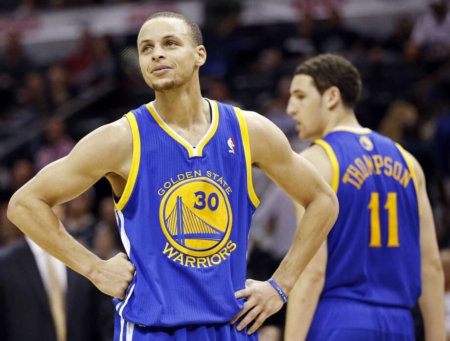 The Warriors' Stephen Curry and Warriors' Klay Thompson pause during a timeout in second half action of Game 2 in the Western Conference semifinals against the Spurs on Wednesday, May 8, 2013 at the AT&T Center. The Warriors won 100-91.