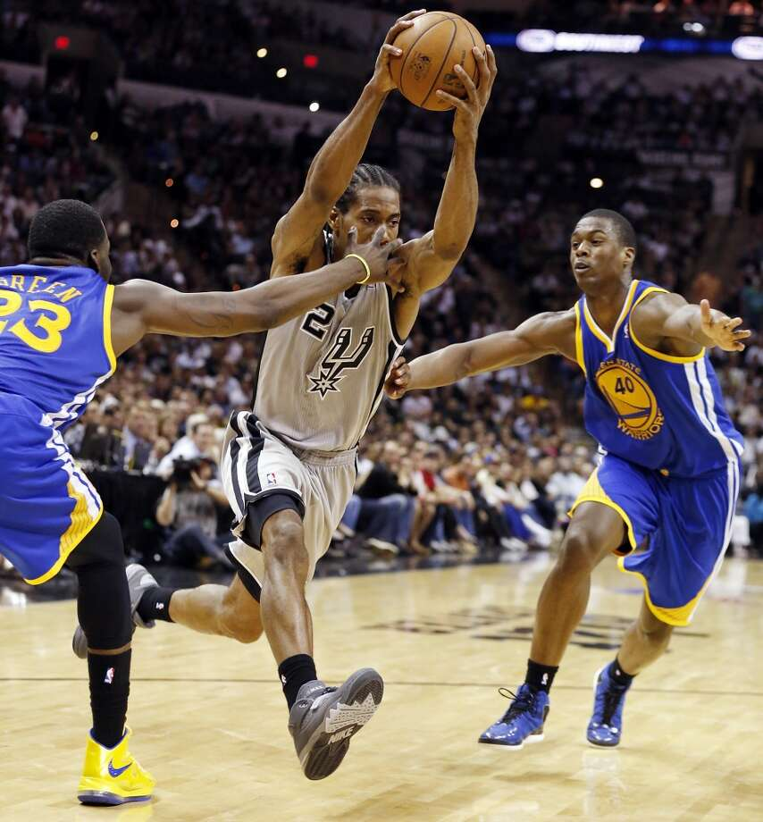 The Spurs' Kawhi Leonard looks for room between the Warriors' Draymond Green and Harrison Barnes during second half action of Game 2 in the Western Conference semifinals Wednesday, May 8, 2013 at the AT&T Center. The Warriors won 100-91.