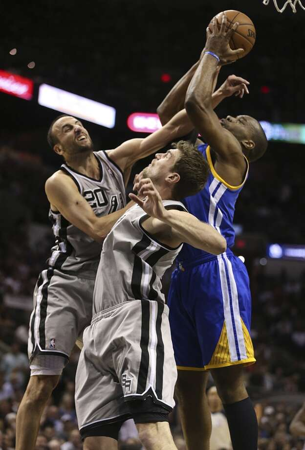 The Warriors' Carl Landry drives as the Spurs' Manu Ginobili and Tiago Splitter defend during the second half of Game 2 in the Western Conference semifinals at the AT&T Center, Wednesday, May 8, 2013. The Warriors won, 100-91 to even the series at 1-1.