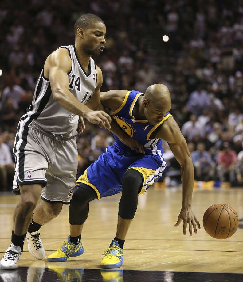 Golden State Warriors' Jarrett Jack keeps the ball away from San Antonio Spurs' Gary Neal during the second half of Game 2 in the NBA Western Conference semifinals at the AT&T Center, Wednesday, May 8, 2013. The Warriors won, 100-91 to even the series at 1-1.