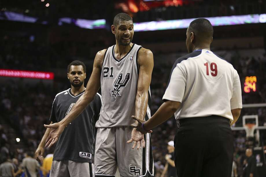 San Antonio Spurs' Tim Duncan pleads his case with official James Capers during the second half of Game 2 in the NBA Western Conference semifinals against the Golden State Warriors at the AT&T Center, Wednesday, May 8, 2013. The Warriors won, 100-91 to even the series at 1-1. In back is Patty Mills.