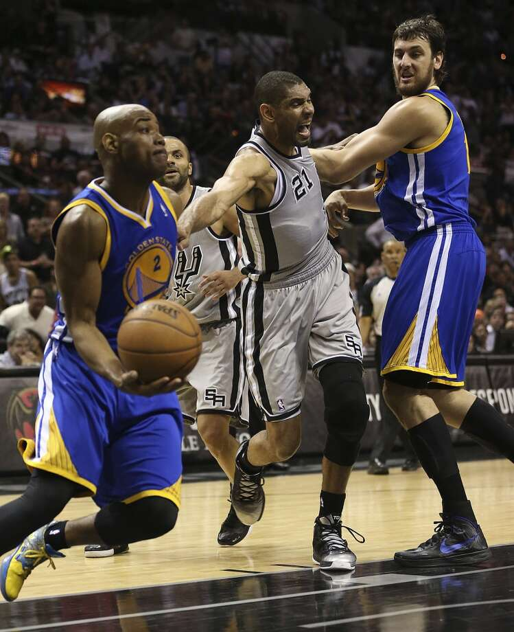 San Antonio Spurs' Tim Duncan is blocked by Golden State Warriors' Andrew Bogut as he chases after Jarrett Jack during the second half of Game 2 in the NBA Western Conference semifinals at the AT&T Center, Wednesday, May 8, 2013. The Warriors won, 100-91 to even the series at 1-1.