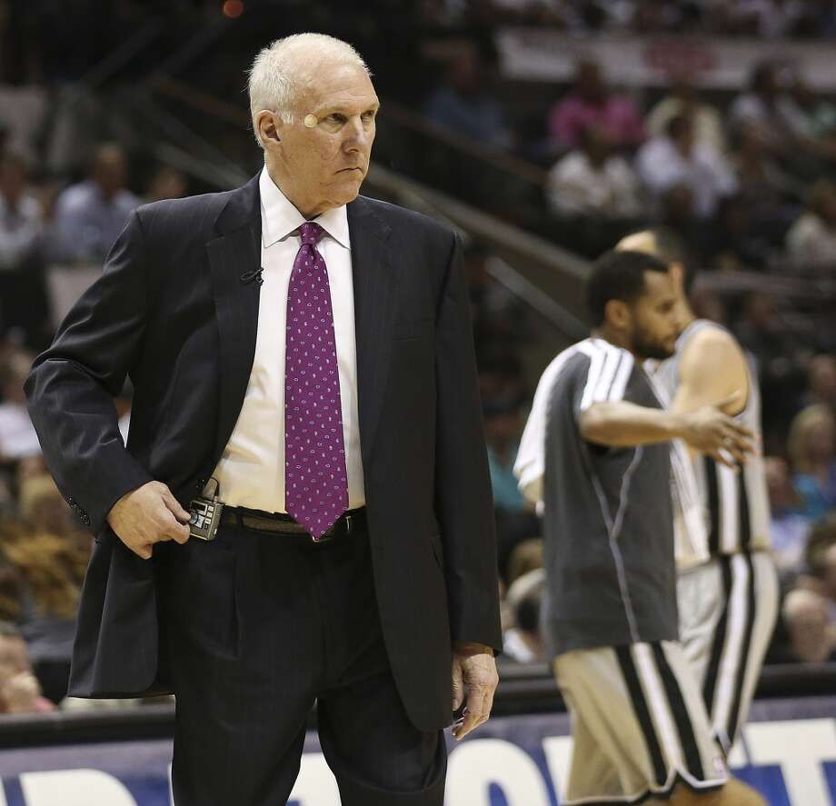 San Antonio Spurs head coach Gregg Popovich calls a timeout during the first half of Game 2 in the NBA Western Conference semifinals against the Golden State Warriors at the AT&T Center, Wednesday, May 8, 2013. e