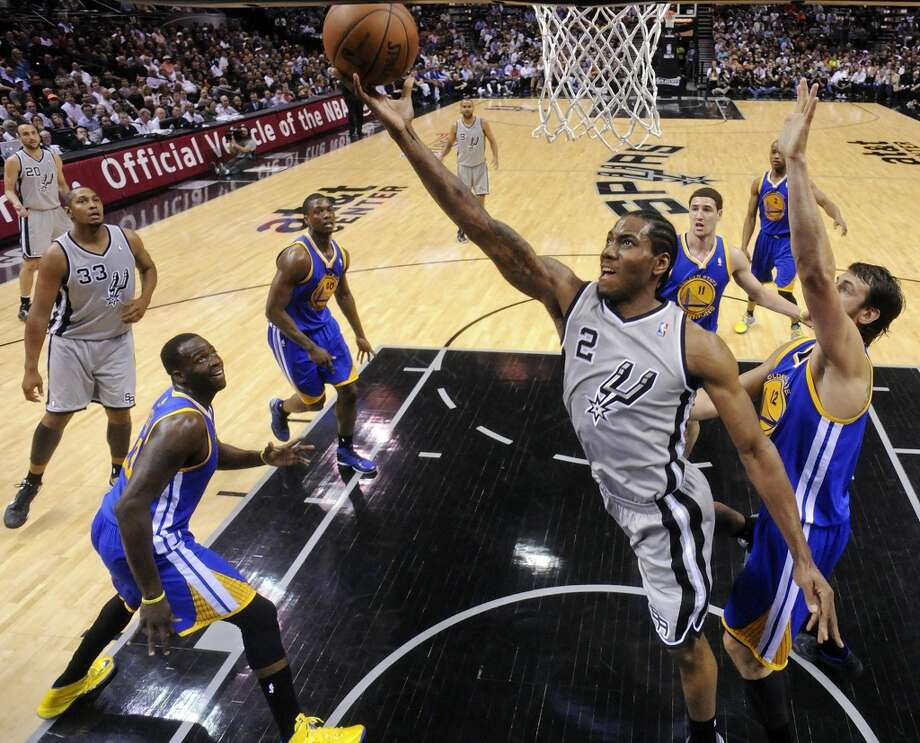 San Antonio Spurs' Kawhi Leonard shoots around Golden State Warriors' Andrew Bogut during first half action of Game 2 in the NBA Western Conference semifinals Wednesday May 8, 2013 at the AT&T Center. The Warriors won 100-91.
