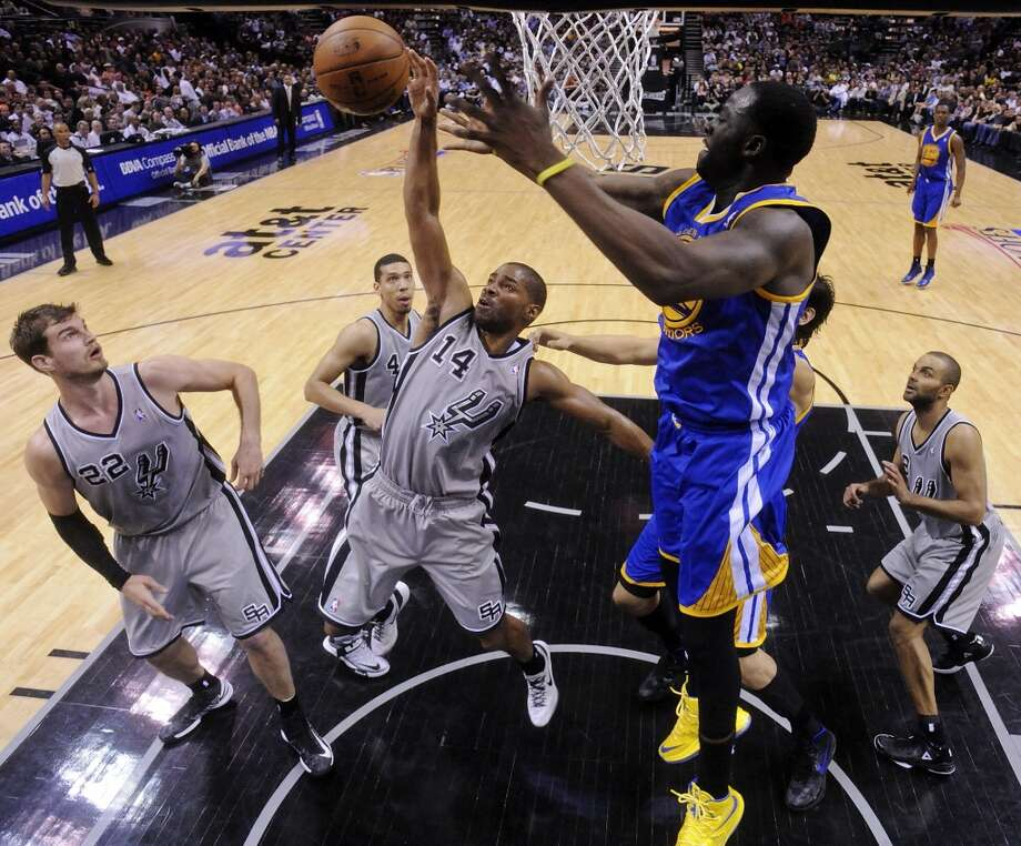 San Antonio Spurs' Gary Neal and Golden State Warriors' Draymond Green grab for a rebound during second half action of Game 2 in the NBA Western Conference semifinals Wednesday May 8, 2013 at the AT&T Center. The Warriors won 100-91.