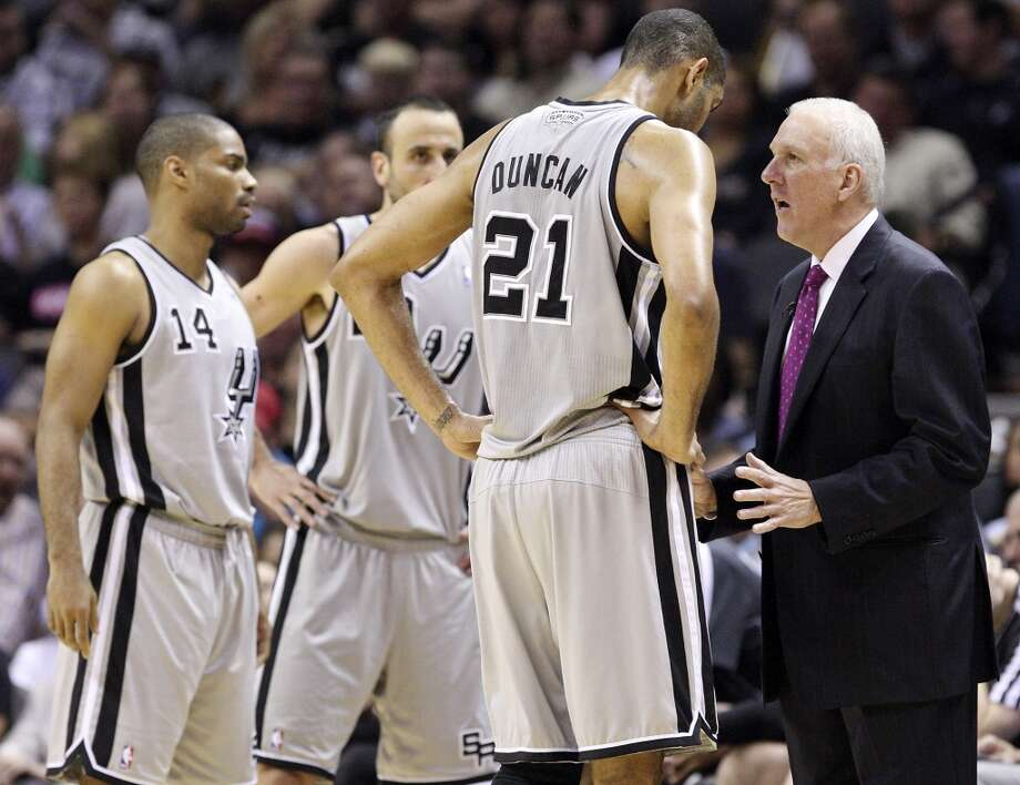 San Antonio Spurs' Tim Duncan talks with San Antonio Spurs head coach Gregg Popovich during first half action of Game 2 in the NBA Western Conference semifinals against the Golden State Warriors Wednesday May 8, 2013 at the AT&T Center.