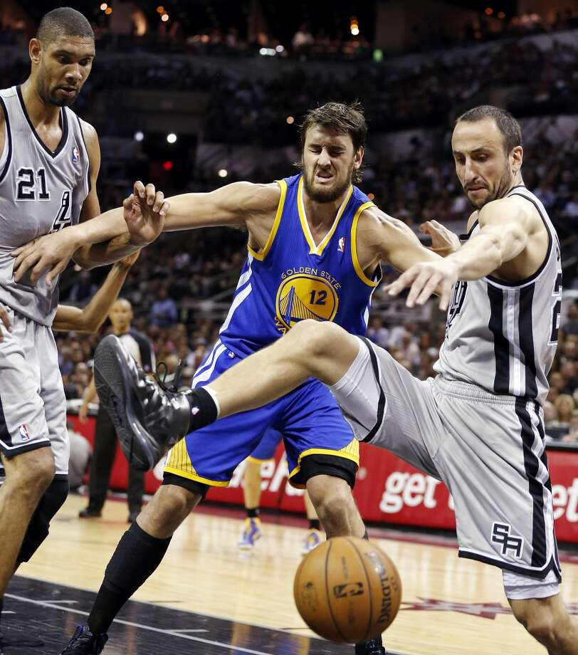 San Antonio Spurs' Tim Duncan and San Antonio Spurs' Manu Ginobili grab for a loose ball against Golden State Warriors' Andrew Bogut during first half action of Game 2 in the NBA Western Conference semifinals Wednesday May 8, 2013 at the AT&T Center.
