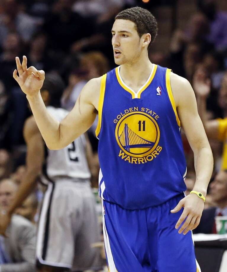 Golden State Warriors' Klay Thompson reacts after making a 3-pointer during second half action of Game 2 in the NBA Western Conference semifinals against the San Antonio Spurs Wednesday May 8, 2013 at the AT&T Center. The Warriors won 100-91.