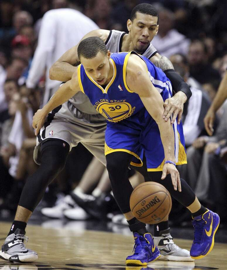 Golden State Warriors' Stephen Curry looks for room around San Antonio Spurs' Danny Green during second half action of Game 2 in the NBA Western Conference semifinals Wednesday May 8, 2013 at the AT&T Center. The Warriors won 100-91.