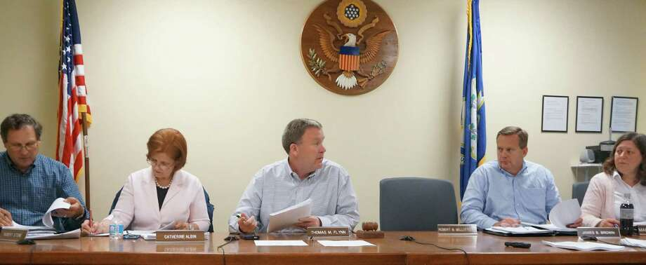 Members of the Board of Finance -- Chairman Thomas Flynn, center -- unanimously approved a new 2013-14 tax rate of 23.93 mills, a 2.38 percent increase, on Wednesday night.   FAIRFIELD CITIZEN, CT 5/8/13 Photo: Genevieve Reilly / Fairfield Citizen