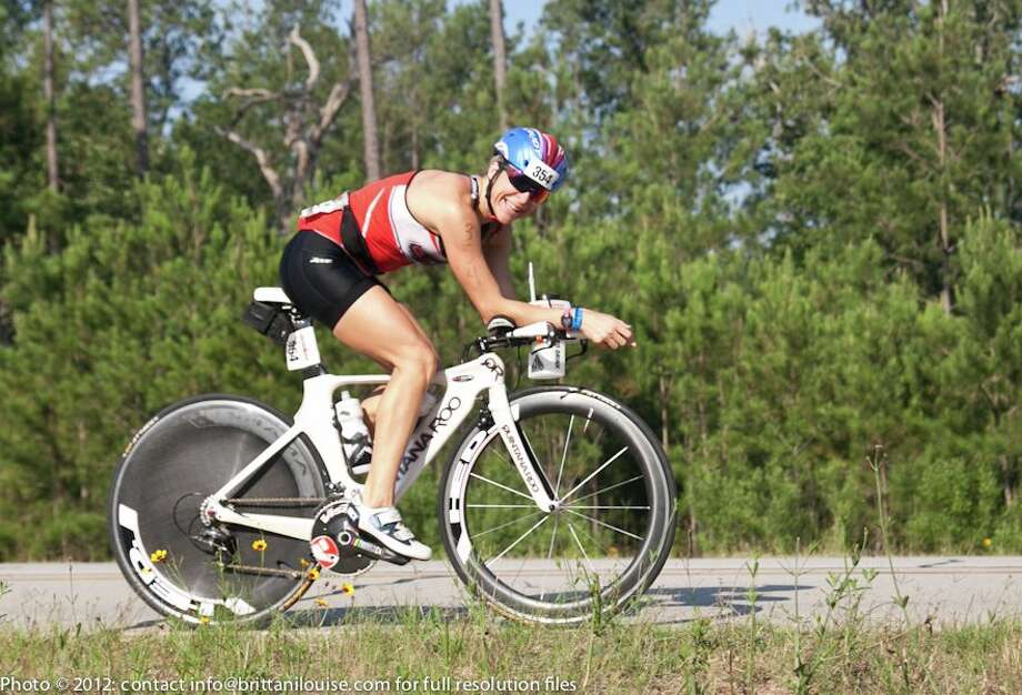 In addition to coaching, Michelle LeBlanc participates in many races, such as the 2012 Memorial Hermann Ironman Texas.