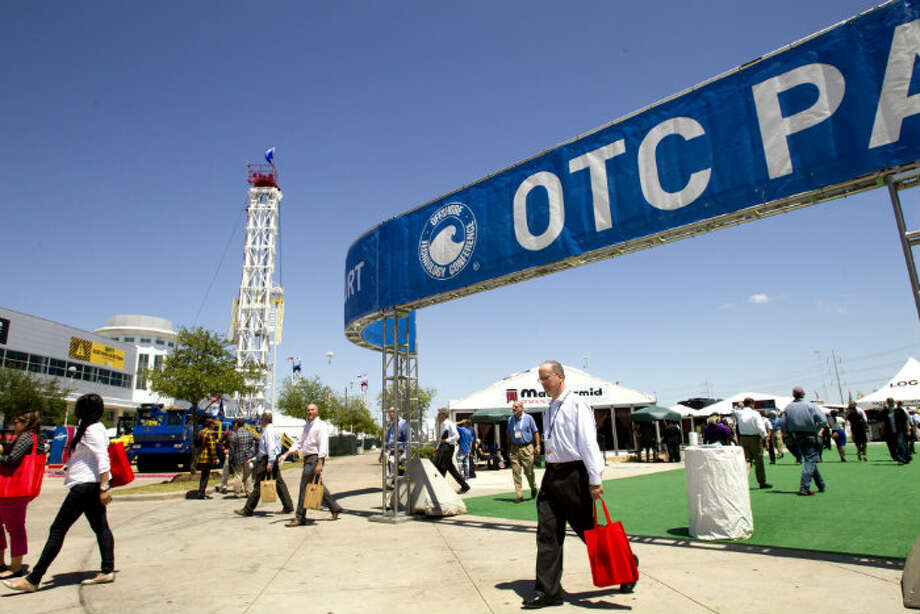 Visitors to OTC2013 walk around the exhibits outdoors at Reliant Park Wednesday, May 8, 2013, in Houston. ( Brett Coomer / Houston Chronicle )