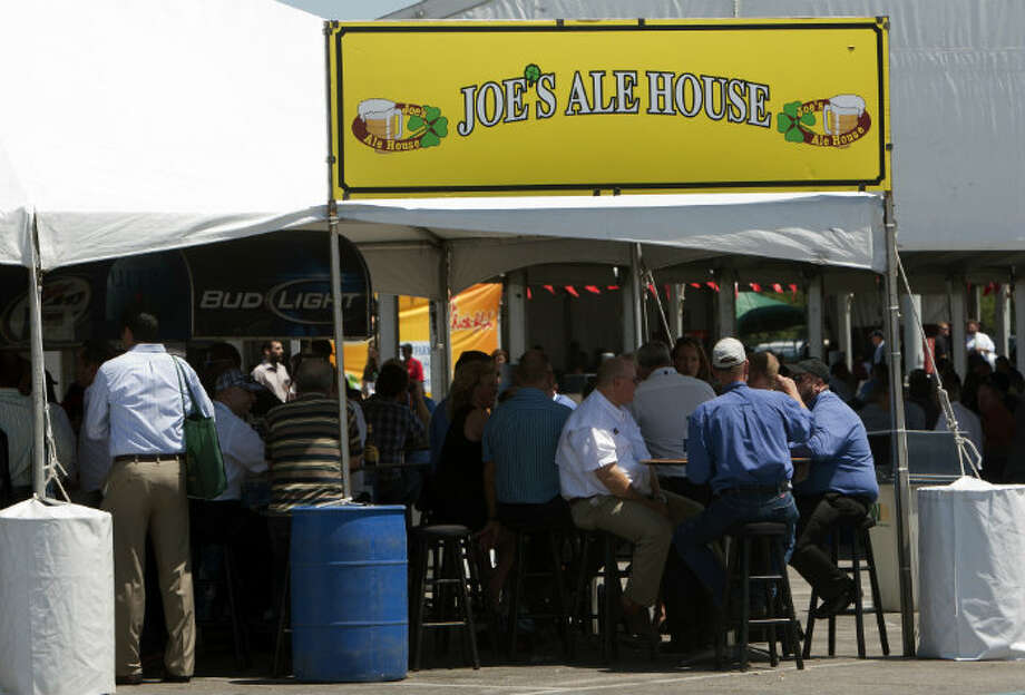 Attendees take a break at Joe's Ale House during day three of the Offshore Technology Conference at Reliant Center Wednesday, May 8, 2013, in Houston. (Cody Duty / Houston Chronicle)