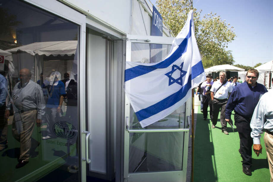 Visitors to OTC2013 walk past the Israel booth at Reliant Park Wednesday, May 8, 2013, in Houston. ( Brett Coomer / Houston Chronicle )