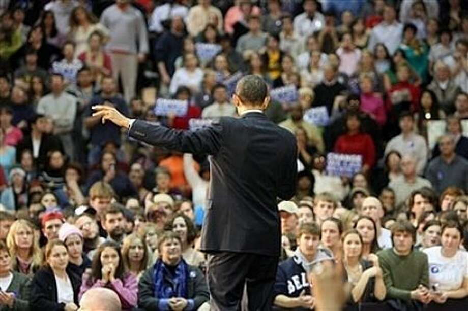Presidential hopeful Sen. Barack Obama, D-Ill., makes remarks during a rally Monday, Feb. 18, 2008, in Beloit, Wis. Photo: Rick Bowmer, AP / AP